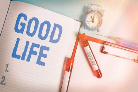 Writing note showing Good Life. Business concept for living in comfort and luxury with few problems or worries Blood sample vial medical accessories ready for examination