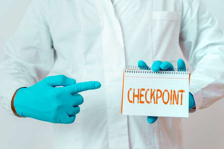 Writing note showing Checkpoint. Business concept for manned entrance, where travelers are subject to security checks Laboratory Technician Featuring Sticker Paper Smartphone