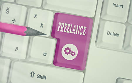 Writing note showing Freelance. Business concept for an individual who pursues a profession without a longterm commitment Colored keyboard key with accessories arranged on empty copy space