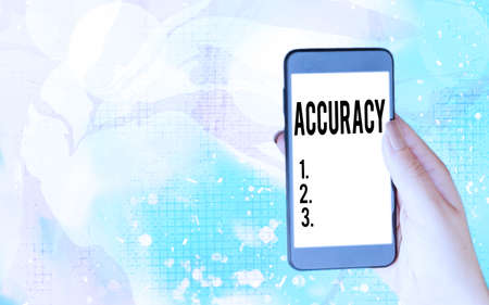 Word writing text Accuracy. Business photo showcasing degree of conformity of a measure to a standard or a true value Modern gadgets with white display screen under colorful bokeh background