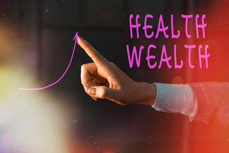 Writing note showing Health Wealth. Business concept for healthy mind and body can bring you wealth and happiness Digital arrowhead curve denoting growth development concept Archivio Fotografico