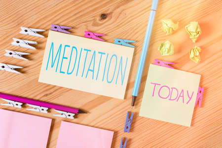 Handwriting text writing Meditation. Conceptual photo the discourse intended to express its author s is reflections Colored clothespin papers empty reminder wooden floor background office 스톡 콘텐츠