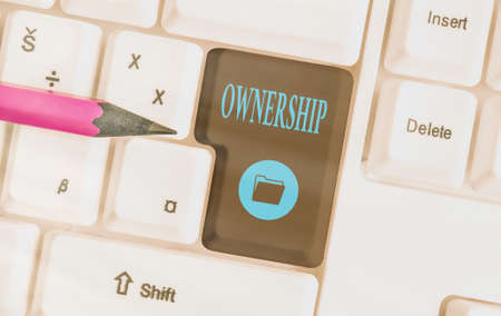 Text sign showing Ownership. Business photo showcasing the state, relation, or fact of being an owner or with a group Different colored keyboard key with accessories arranged on empty copy space