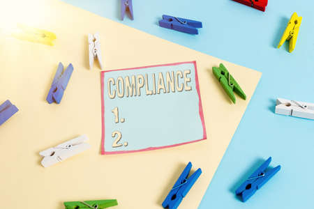 Word writing text Compliance. Business photo showcasing ability of an object to yield elastically when a force is applied Colored clothespin paper empty reminder yellow blue floor background office