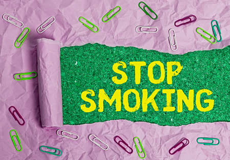 Word writing text Stop Smoking. Business photo showcasing the process of discontinuing or quitting tobacco smoking Rolled ripped torn cardboard placed above a wooden classic table backdrop