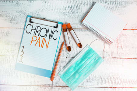 Conceptual hand writing showing Chronic Pain. Concept meaning discomfort that persists or progresses over a long period Blood sample vial medical accessories ready for examination