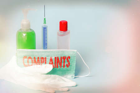 Handwriting text writing Complaints. Conceptual photo something that is the cause or subject of protest or outcry Primary medical precautionary equipments for health care protection Фото со стока