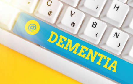 Writing note showing Dementia. Business concept for usually, a progressive condition marked by multiple deficits Colored keyboard key with accessories arranged on empty copy space