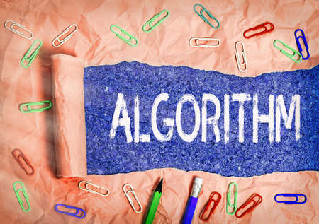 Text sign showing Algorithm. Business photo text procedure for solving a problem or accomplishing tasks etc. Rolled ripped torn cardboard placed above a wooden classic table backdrop