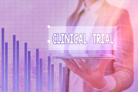 Handwriting text Clinical Trial. Conceptual photo evaluate the effectiveness and safety of medications Arrow symbol going upward denoting points showing significant achievement Banque d'images