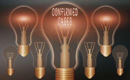 Conceptual hand writing showing Confirmed Cases. Concept meaning set of circumstances or conditions requiring action Realistic colored vintage light bulbs, idea sign solution