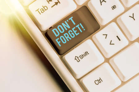 Handwriting text Don T Forget. Conceptual photo used to remind someone about an important fact or detail Different colored keyboard key with accessories arranged on empty copy space