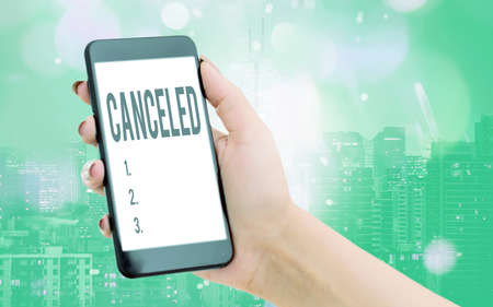 Writing note showing Canceled. Business concept for to decide not to conduct or perform something planned or expected Modern gadgets white screen under colorful bokeh background