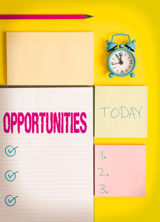 Text sign showing Opportunities. Business photo showcasing good chance for advancement, favorable juncture circumstance Colored empty papers with copy space on the yellow background table Reklamní fotografie
