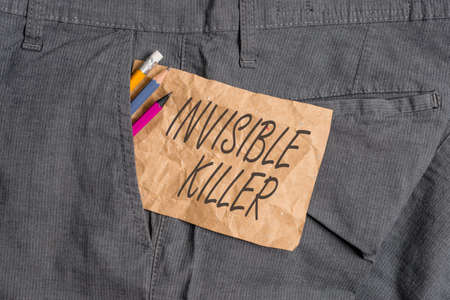 Word writing text Invisible Killer. Business photo showcasing presence into the air of a substance which are harmful Writing equipment and brown note paper inside pocket of man work trousers