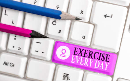 Conceptual hand writing showing Exercise Every Day. Concept meaning move body energetically in order to get fit and healthy Colored keyboard key with accessories arranged on copy space