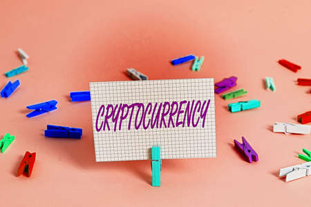Writing note showing Cryptocurrency. Business concept for form of currency that exists digitally has no central issuing Colored crumpled rectangle shaped reminder paper light blue background