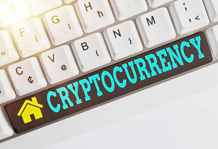 Text sign showing Cryptocurrency. Business photo showcasing form of currency that exists digitally has no central issuing Different colored keyboard key with accessories arranged on empty copy space