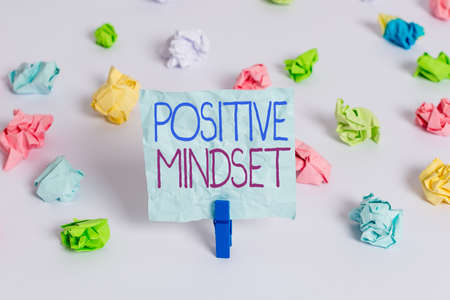 Handwriting text Positive Mindset. Conceptual photo mental attitude in which you expect favorable results Colored crumpled papers empty reminder white floor background clothespin
