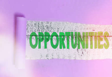 Text sign showing Opportunities. Business photo showcasing good chance for advancement, favorable juncture circumstance Rolled ripped torn cardboard placed above a wooden classic table backdrop