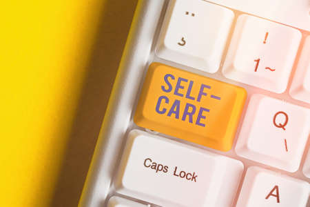 Text sign showing Self Care. Business photo text the practice of taking action to improve one s is own health Different colored keyboard key with accessories arranged on empty copy space