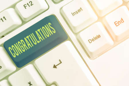 Text sign showing Congratulations. Business photo showcasing a congratulatory expression usually used in plural form Different colored keyboard key with accessories arranged on empty copy space Foto de archivo