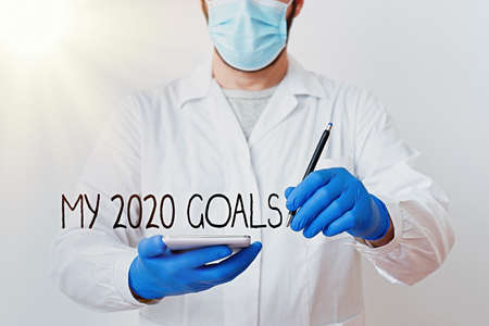 Text sign showing My 2020 Goals. Business photo showcasing setting up an individualal goals or plans for the current year Laboratory Technician Featuring Empty Sticker Paper Accessories Smartphone