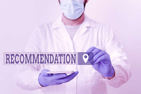 Handwriting text Recommendation. Conceptual photo something that recommends or expresses commendation Laboratory Technician Featuring Empty Sticker Paper Accessories Smartphone 版權商用圖片
