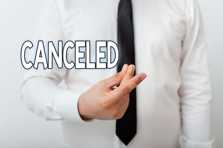 Text sign showing Canceled. Business photo showcasing to decide not to conduct or perform something planned or expected Model with pointing hand finger symbolizing navigation progress growth 免版税图像