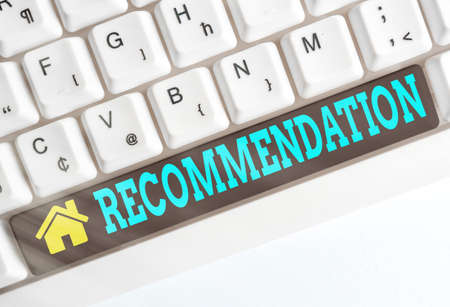 Text sign showing Recommendation. Business photo showcasing something that recommends or expresses commendation Different colored keyboard key with accessories arranged on empty copy space Imagens