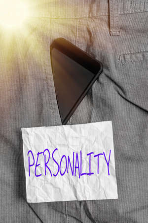 Text sign showing Personality. Business photo text the condition or fact of relating to a particular an individual Smartphone device inside formal work trousers front pocket near note paper