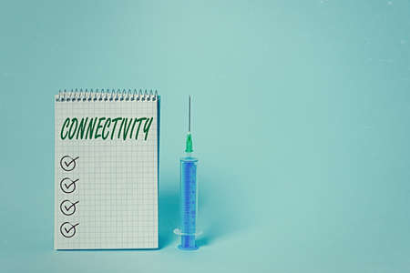 Conceptual hand writing showing Connectivity. Concept meaning quality, state, or capability of being connective or connected Set of medical equipment with notepad for health assessment