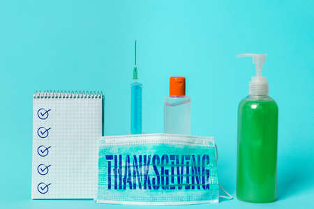 Writing note showing Thanksgiving. Business concept for public acknowledgment or celebration of divine goodness Set of medical equipment with notepad for health condition assessment