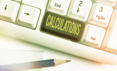 Text sign showing Calculations. Business photo text mathematical determination of the size or number of something Different colored keyboard key with accessories arranged on empty copy space