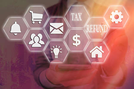 Word writing text Tax Refund. Business photo showcasing refund on tax when the tax liability is less than the tax paid Grids and different set up of the icons latest digital technology concept