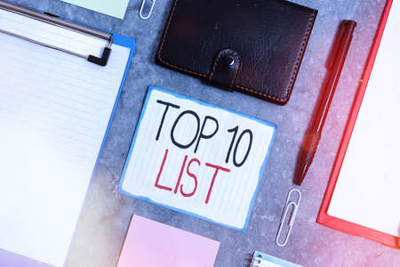 Handwriting text Top 10 List. Conceptual photo the ten most important or successful items in a particular list Paper accesories with digital smartphone arranged on different background