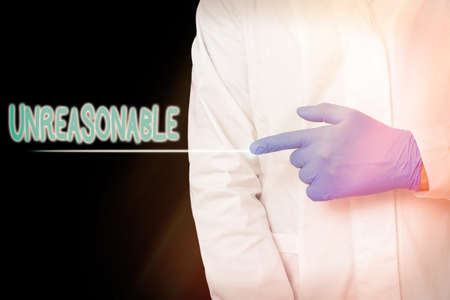 Conceptual hand writing showing Unreasonable. Concept meaning not conformable to reason or exceeding the bounds of reason Displaying Sticker Paper Accessories With Medical Gloves On