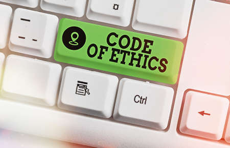 Text sign showing Code Of Ethics. Business photo text basic guide for professional conduct and imposes duties Different colored keyboard key with accessories arranged on empty copy space