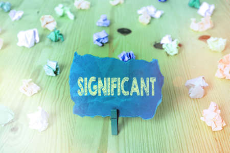 Word writing text Significant. Business photo showcasing sufficiently great or important to be worthy of attention Colored crumpled rectangle shaped reminder paper light blue background