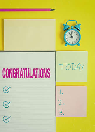 Text sign showing Congratulations. Business photo showcasing a congratulatory expression usually used in plural form Colored empty papers with copy space on the yellow background table