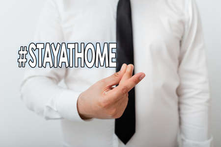 Text sign showing Hashtag Stay at home. Business photo showcasing a trending label in social media related to the coronvirus outbreak Model with pointing hand finger symbolizing navigation progress growth