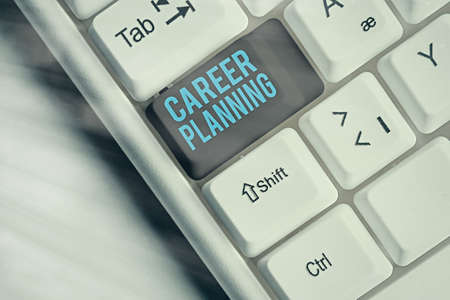 Handwriting text Career Planning. Conceptual photo Strategically plan your career goals and work success Different colored keyboard key with accessories arranged on empty copy space