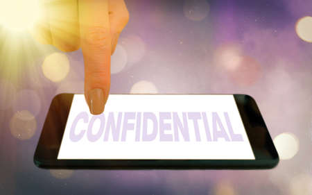 Conceptual hand writing showing Confidential. Concept meaning containing an individualal information whose unauthorized disclosure Modern gadgets white screen under colorful bokeh background