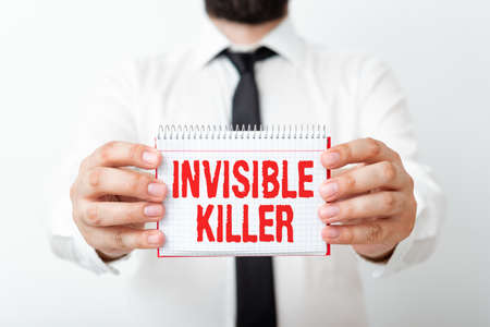Word writing text Invisible Killer. Business photo showcasing presence into the air of a substance which are harmful Model displaying different empty color notepad mock-up for writing idea Фото со стока