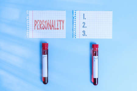 Writing note showing Personality. Business concept for the condition or fact of relating to a particular an individual Blood sample vial medical accessories ready for examination Archivio Fotografico