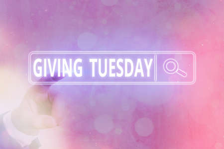 Writing note showing Giving Tuesday. Business concept for international day of charitable giving Hashtag activism Web search digital information futuristic technology network connection 写真素材