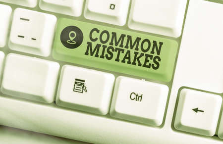 Text sign showing Common Mistakes. Business photo text actions that are often used interchangeably with error Different colored keyboard key with accessories arranged on empty copy space