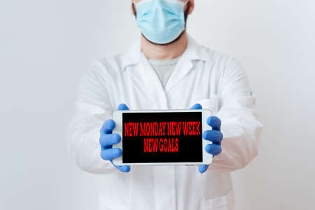Conceptual hand writing showing New Monday New Week New Goals. Concept meaning showcasing next week resolutions To do list Laboratory Technician Featuring Sticker Paper Smartphone