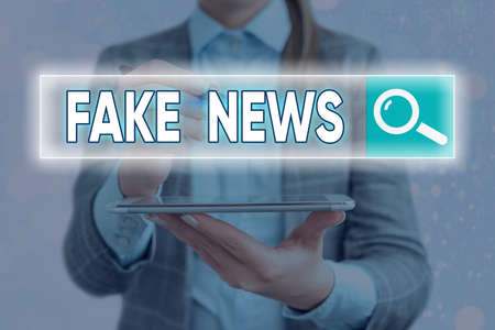 Handwriting text writing Fake News. Conceptual photo false information publish under the guise of being authentic news Web search digital information futuristic technology network connection 版權商用圖片