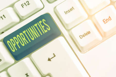Text sign showing Opportunities. Business photo showcasing good chance for advancement, favorable juncture circumstance Different colored keyboard key with accessories arranged on empty copy space